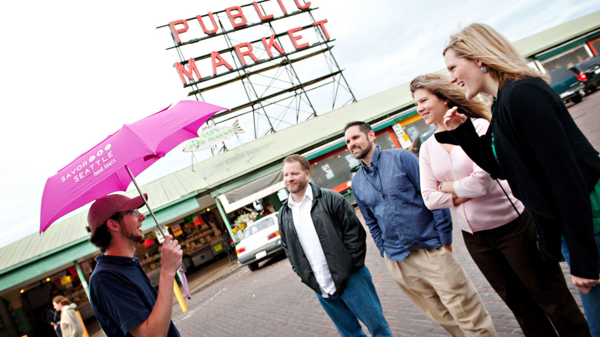 Tour guide with group at Pike Place Market in Seattle