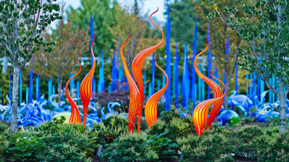 Show item 2 of 9. Brightly colored glass sculpture in the garden at the Chihuly Garden and Glass in Seattle