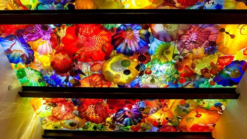 Ceiling top full of colorful glass sculpture of different shapes sizes and colors at the Chihuly Garden and Glass in Seattle