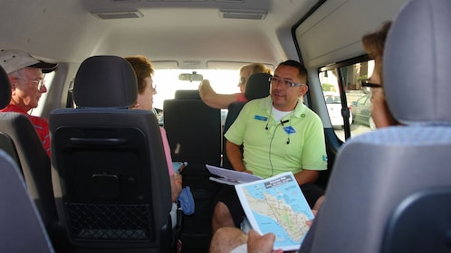 tour guide sitting with passengers in van in Los Cabos