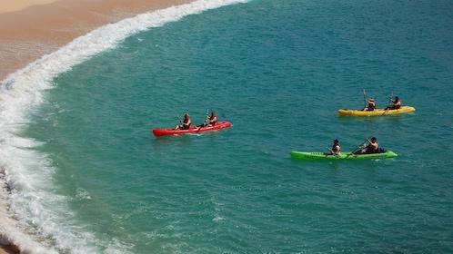 people in kayaks in water in Los Cabos