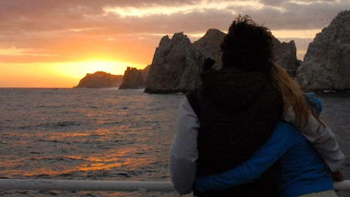 woman leaning on rail of boat in Los Cabos