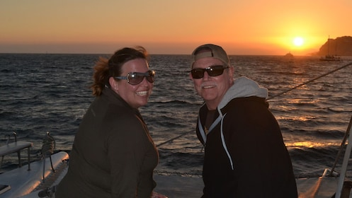 passengers enjoying sunset on boat's deck in Los Cabos
