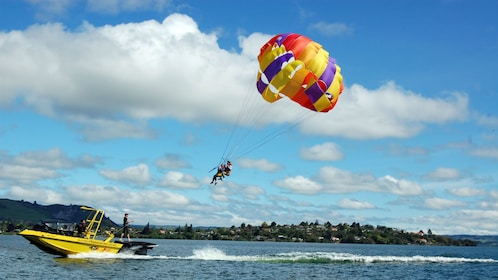 jet boat taking couple parasailing in New Zealand