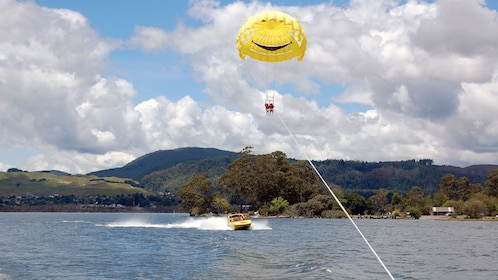 speed boat under a parasailing couple in New Zealand