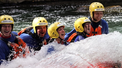 white water rafters partially submerged in water in New Zealand