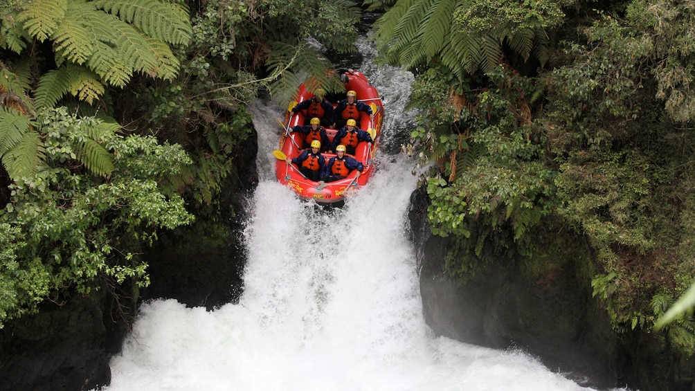 Show item 2 of 5. white water raft sliding down a slope in New Zealand