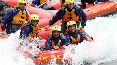 white water rafts side by side in the rapids in New Zealand