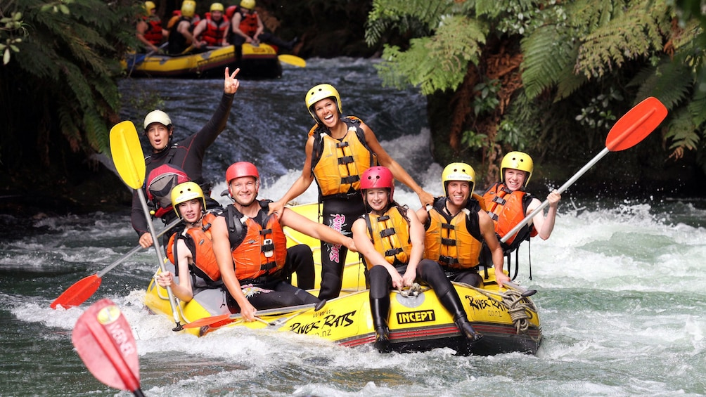 Show item 3 of 5. white water rafters feeling accomplished in New Zealand
