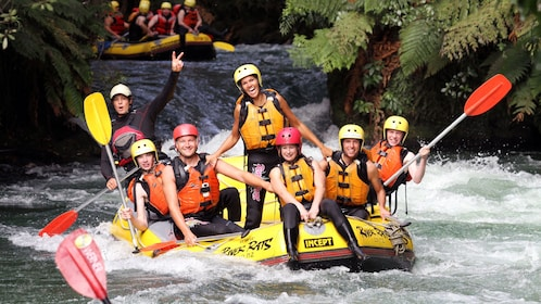 white water rafters feeling accomplished in New Zealand