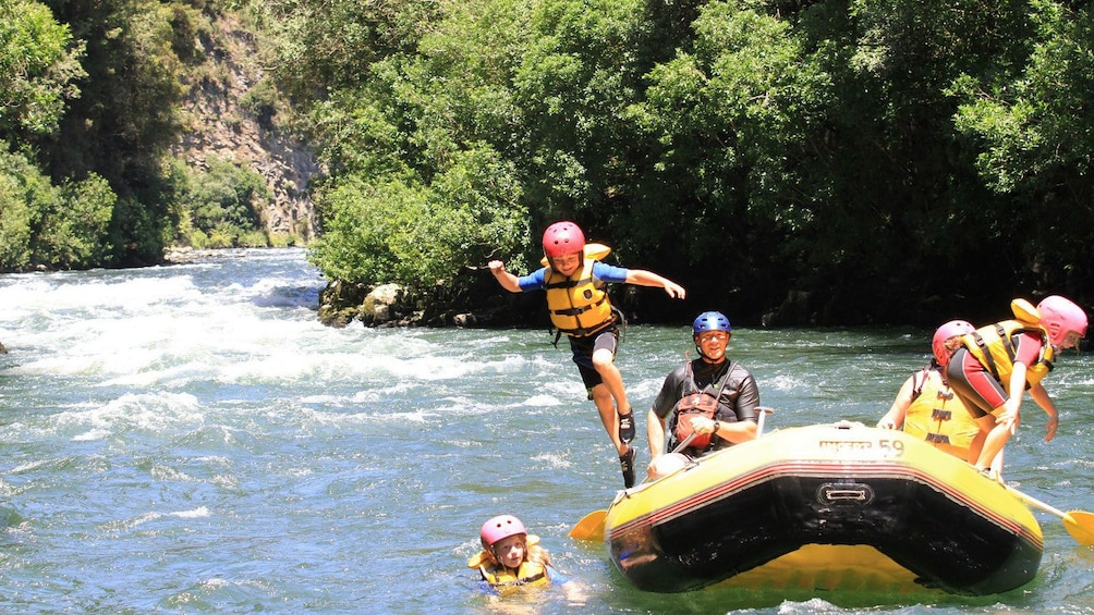 Show item 5 of 5. rafters jump into calmer waters in New Zealand