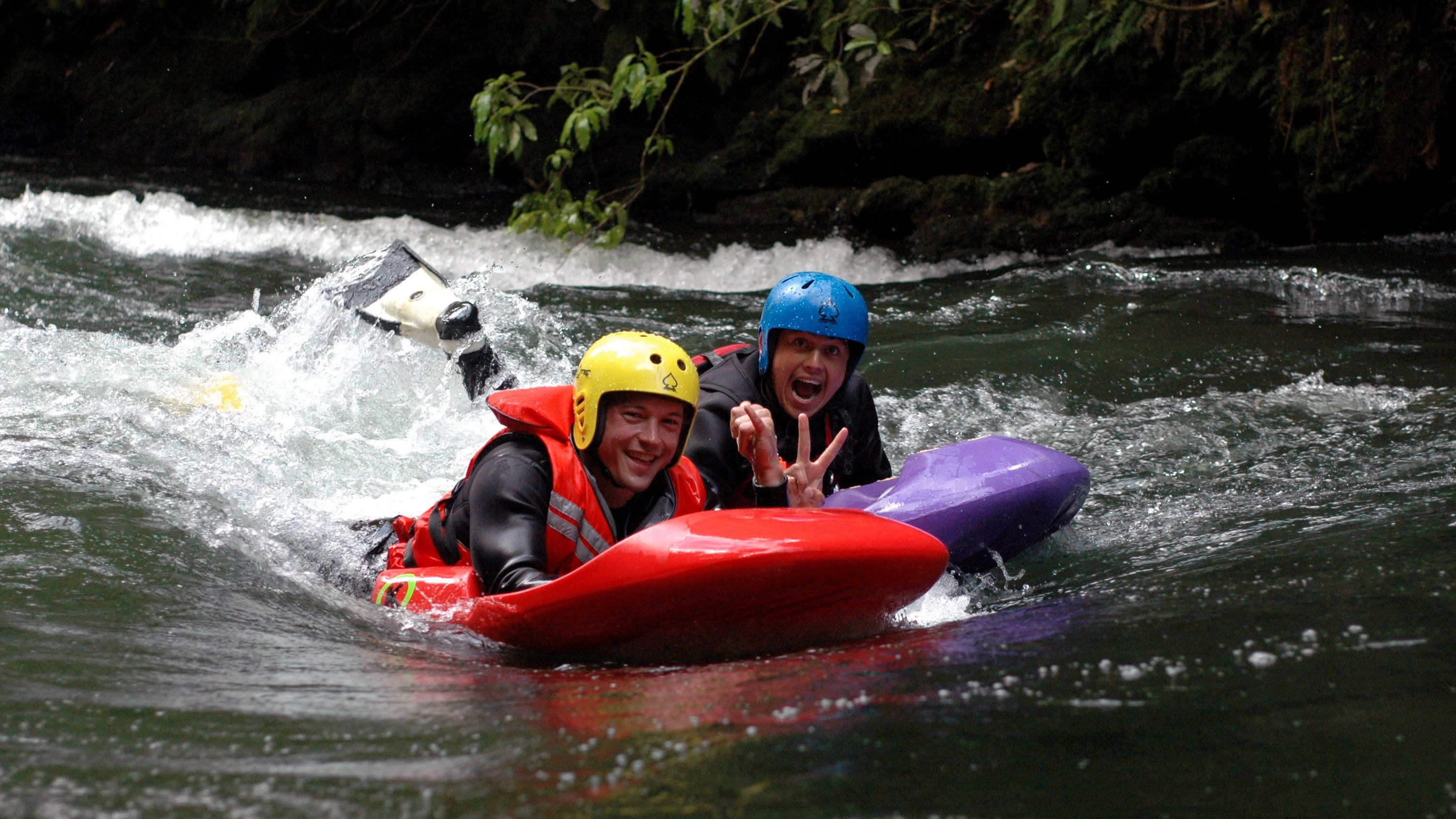 two men river sledging in New Zealand