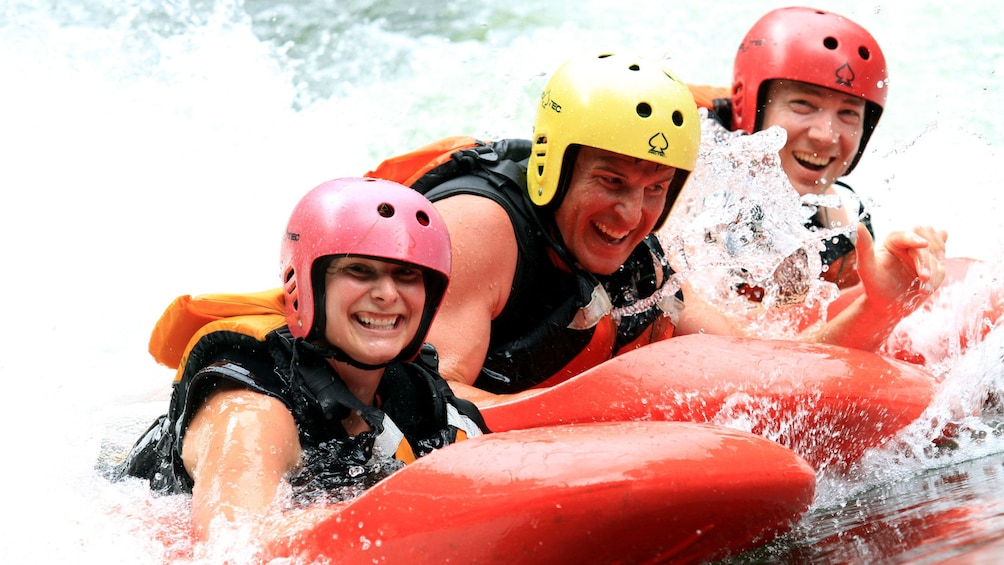 Show item 5 of 5. group having fun river sledging in New Zealand