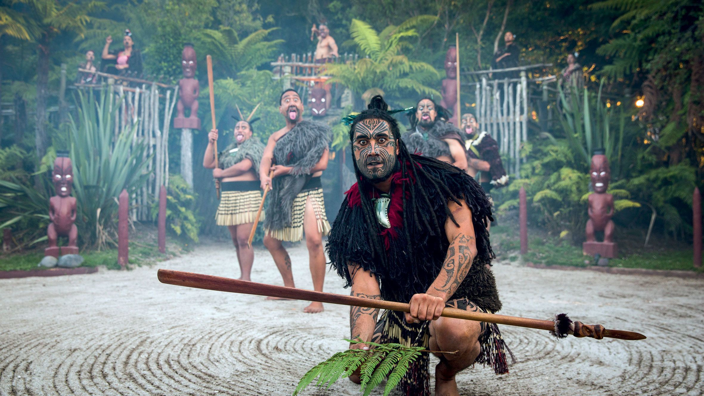 tattooed tribal men in New Zealand