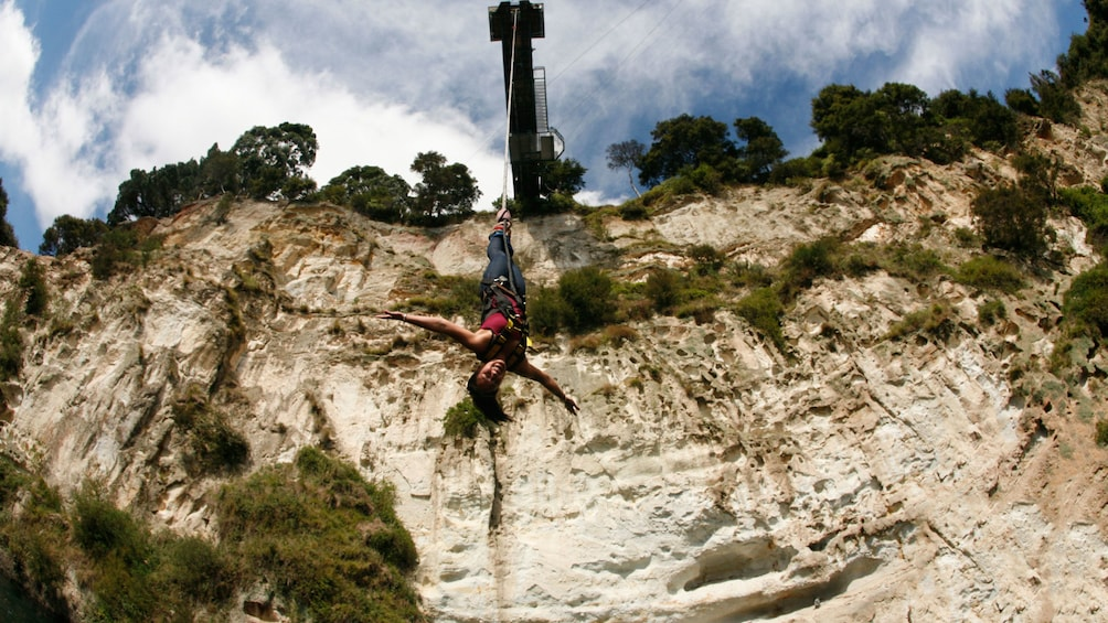 Show item 3 of 7. woman on bungy jump