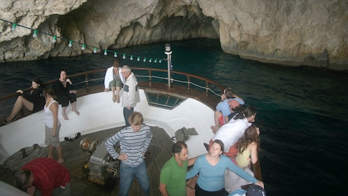 Boat passengers marvel at the rocky cliffs in Corfu