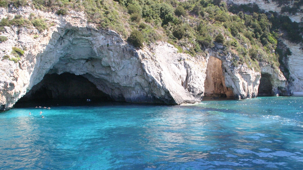 swimming near the cave at the beach in Corfu