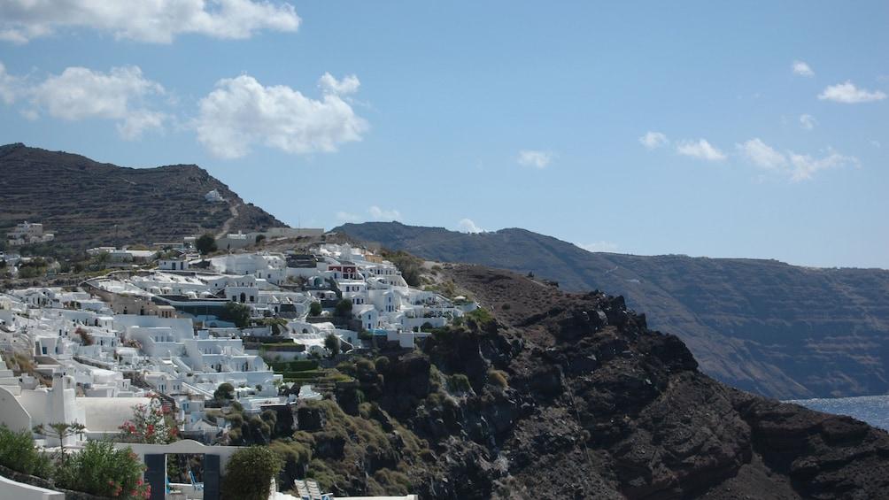 Buildings by the cliffside in Greece
