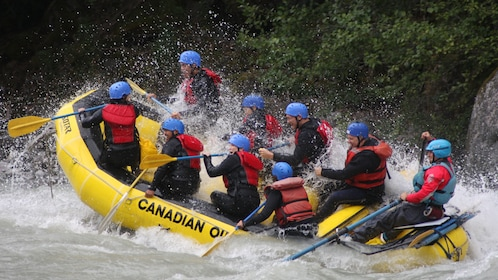 White water raft splashing down the Elaho River in Whistler