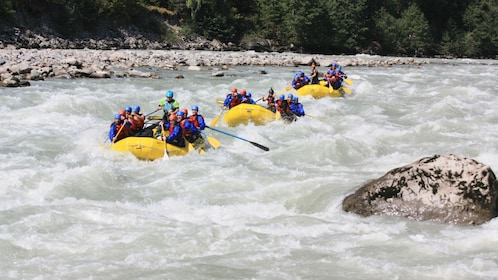 Three rafts on the rapids of the Elaho River in Whistler