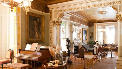 Piano and sitting room inside Craigdarroch Castle in Victoria