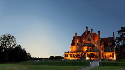 Craigdarroch Castle illuminated as the sun goes down in Victoria
