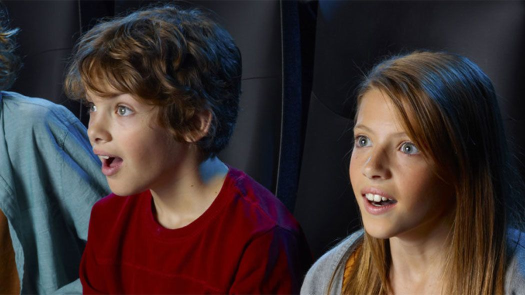 Pair of kids at the National Geographic IMAX Theater in Victoria