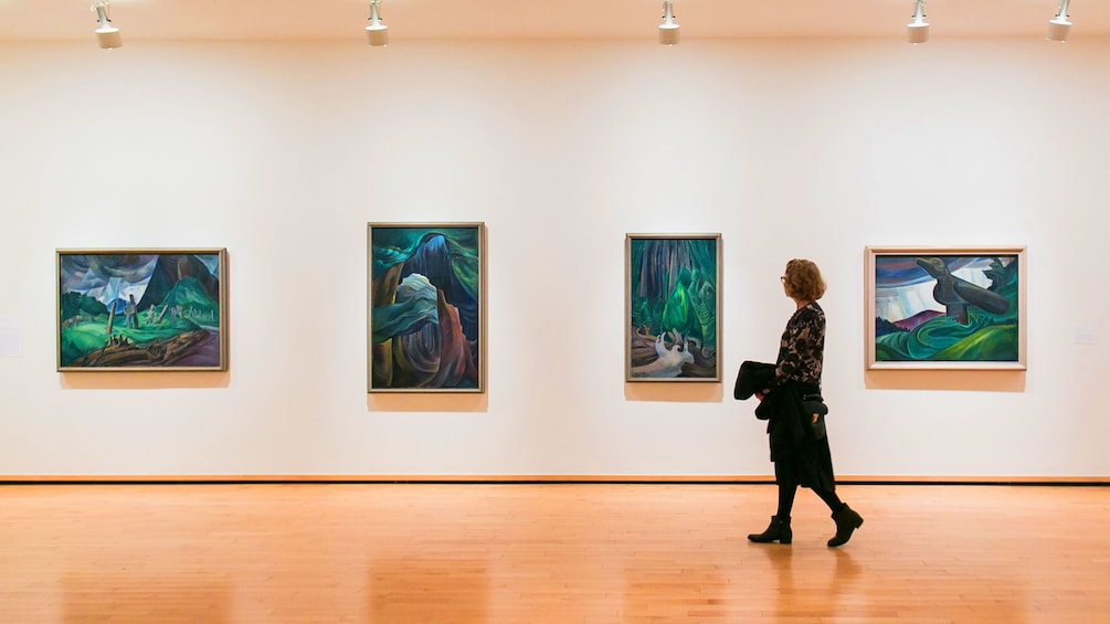 Show item 1 of 8. Woman looks at paintings in Vancouver Art Gallery in Canada