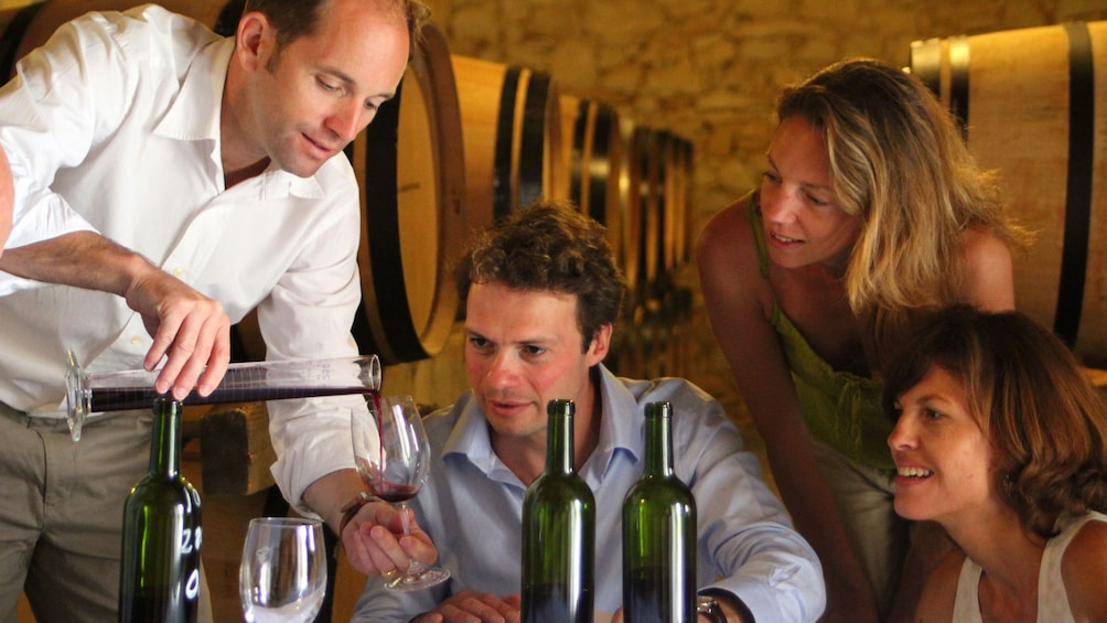 Group of people at a wine tasting in Saint Emilion