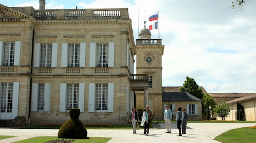 People outside a historic building in France