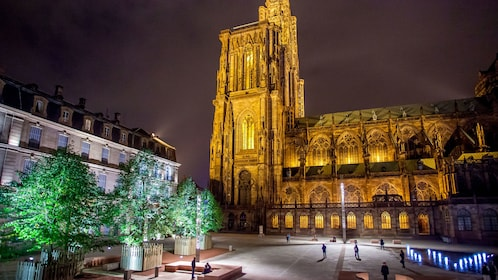 A gothic cathedral illuminated at night in Strasbourg