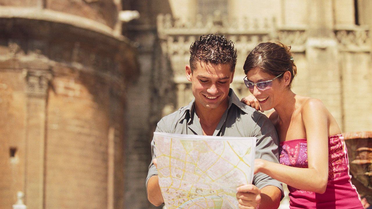 Couple looking at a map in Seville