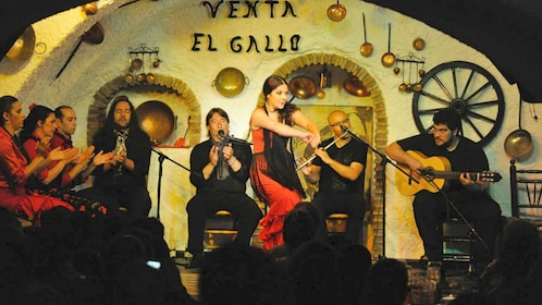 woman dancing on stage with band in spain