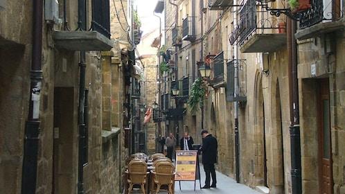 A cute cafe nestled in a street in Spain