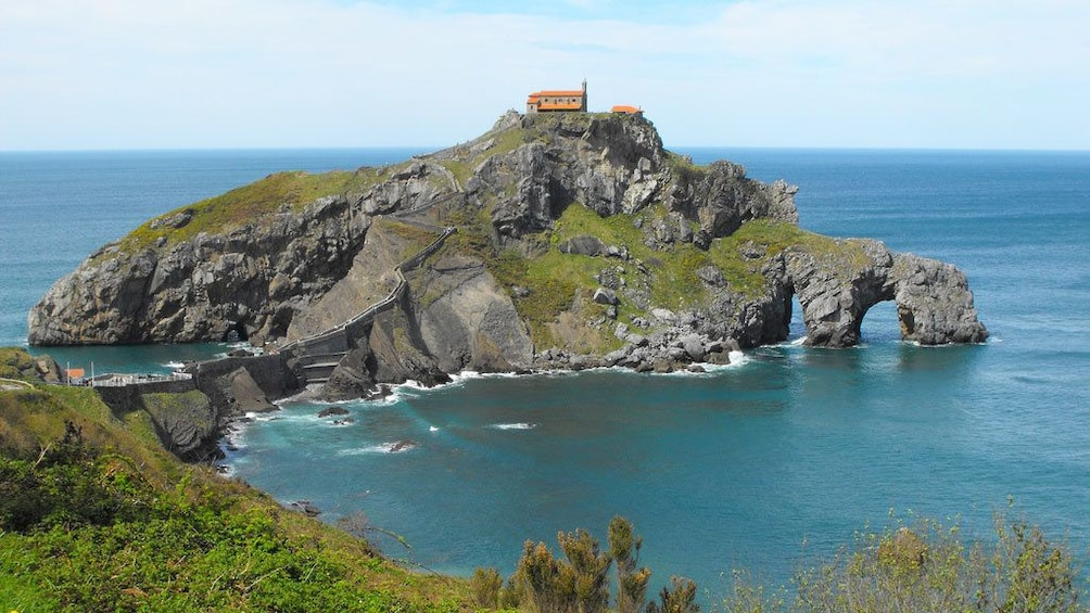 Rocky formation with a church on the Basque coast