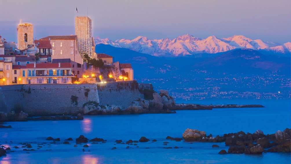 Stunning sunset view of the mountains and water in Monaco