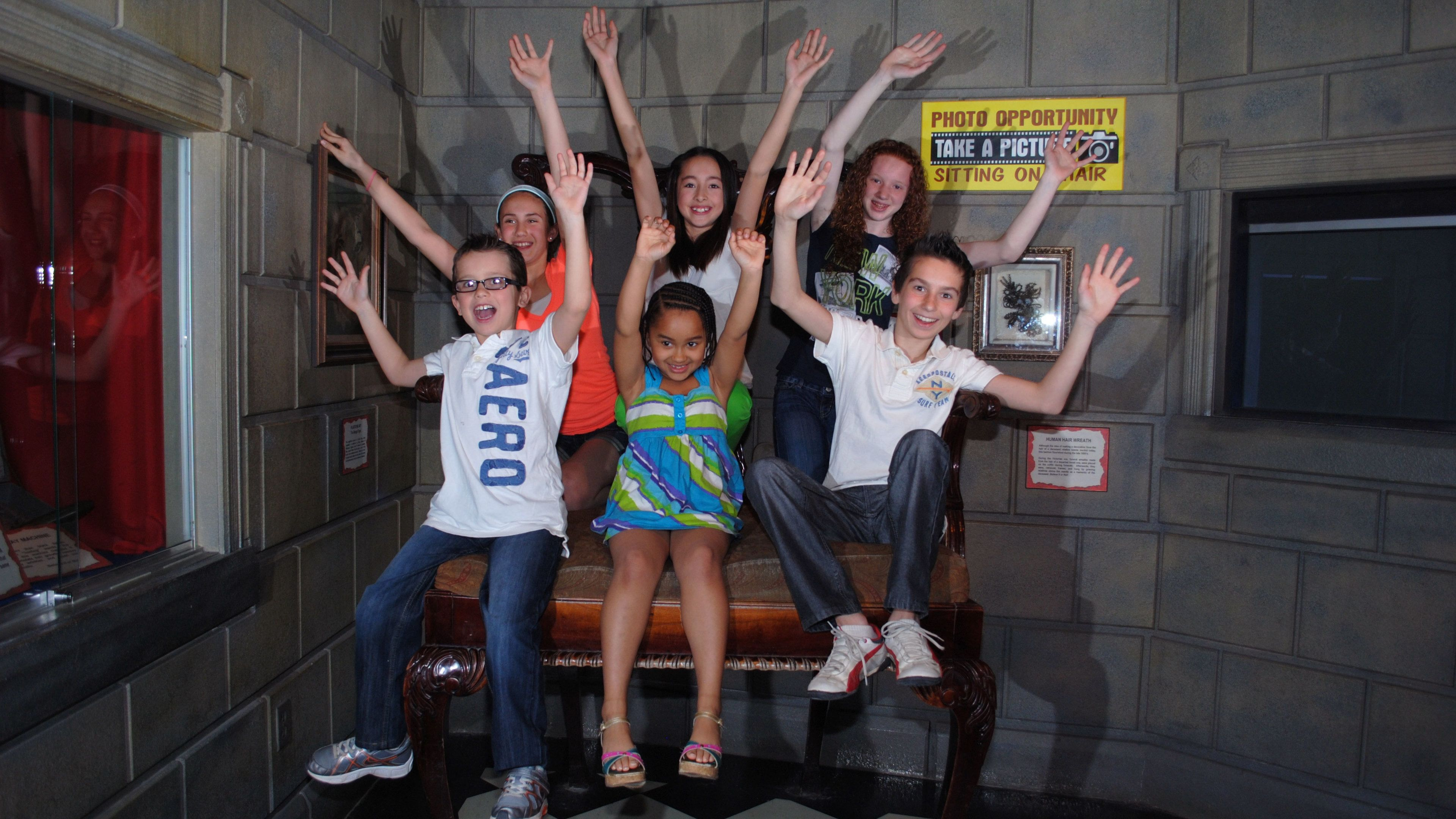 Taking a group photo at Ripley's Believe it or Not Museum in Niagara Falls