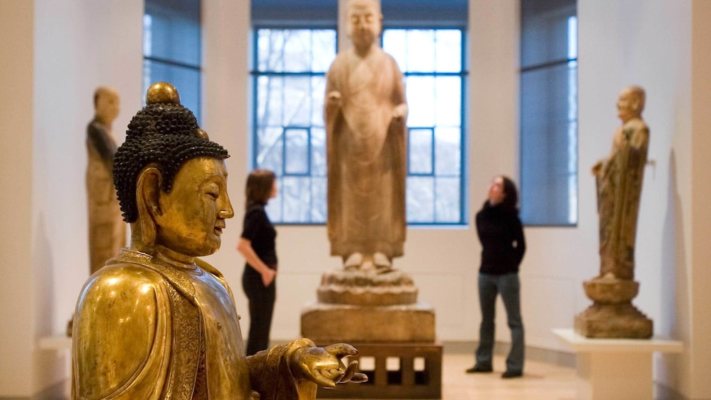 Show item 9 of 9. Ancient Chinese Buddha statue displayed in the Royal Ontario Museum
