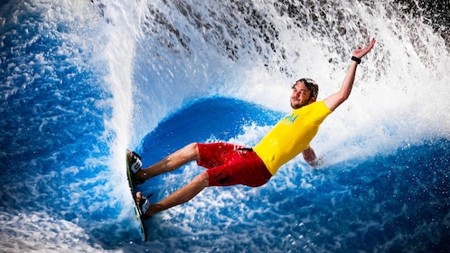 man surfing on water in waterpark in Dubai