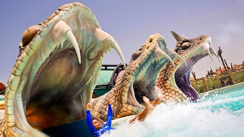 water slides shaped like snake mouths at waterpark in Dubai