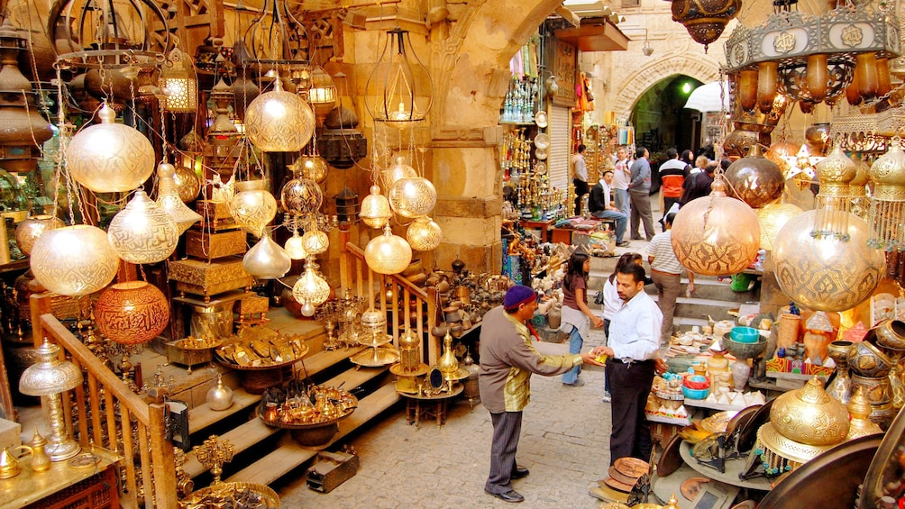 Show item 5 of 7. Customers buying merchandise at the Khan el-Khalili Bazaar in Cairo