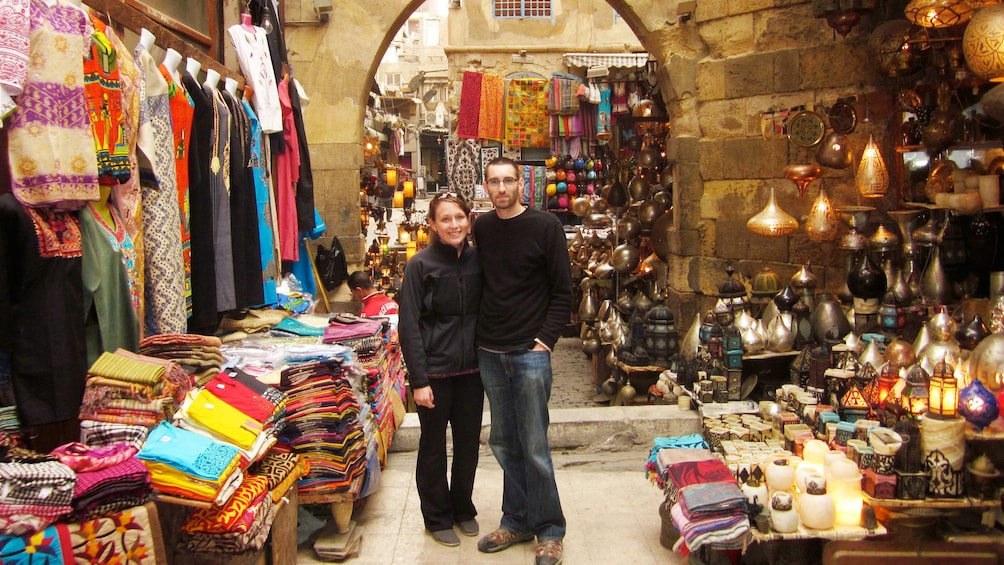 Show item 4 of 7. Tourists take picture at the Khan el-Khalili Bazaar in Cairo