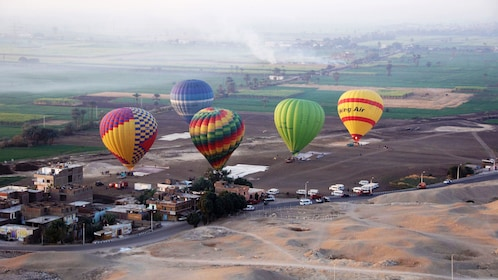 brightly colored hot air balloons in luxor
