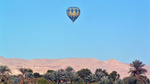 blue and yellow hot air balloon in luxor