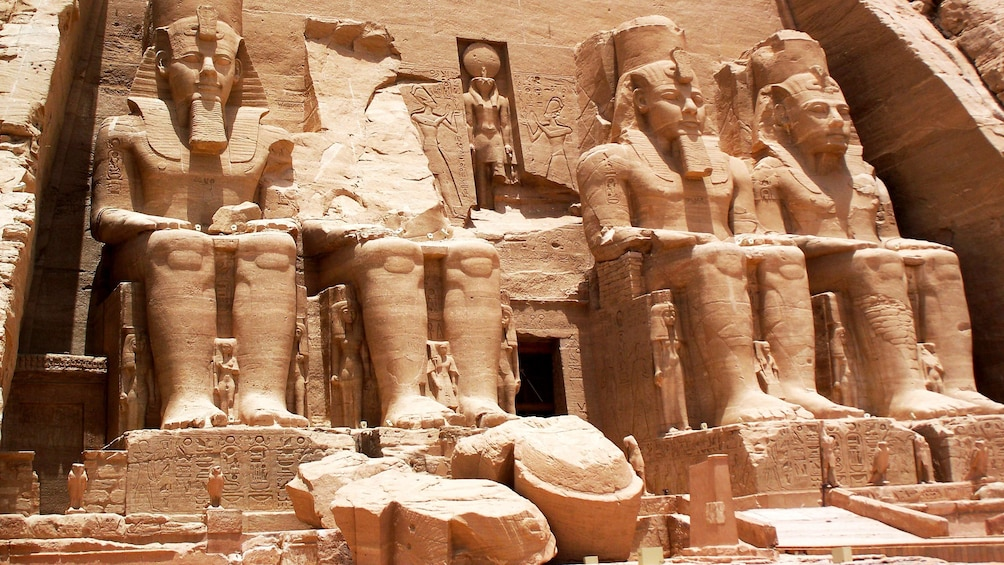 Show item 2 of 8. Facade of the Great Temple at Abu Simple with four large statues of Ramesses II in Aswan