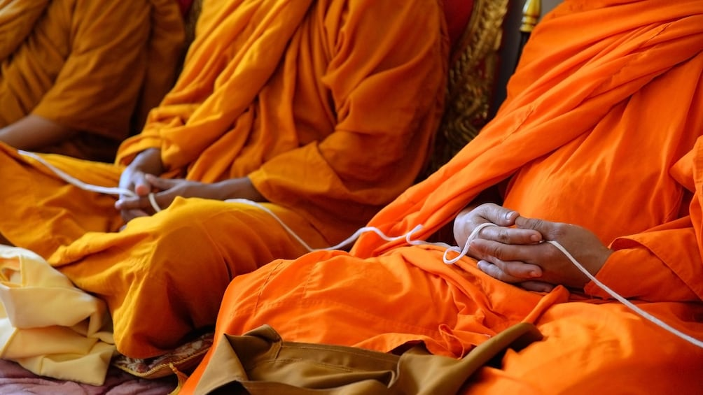 Show item 3 of 5. Close view of Monks meditating in Phuket
