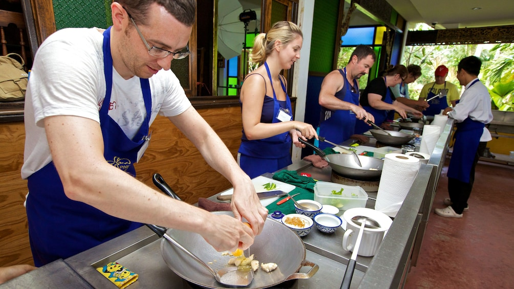 students learning how to cook Thai food in Phuket