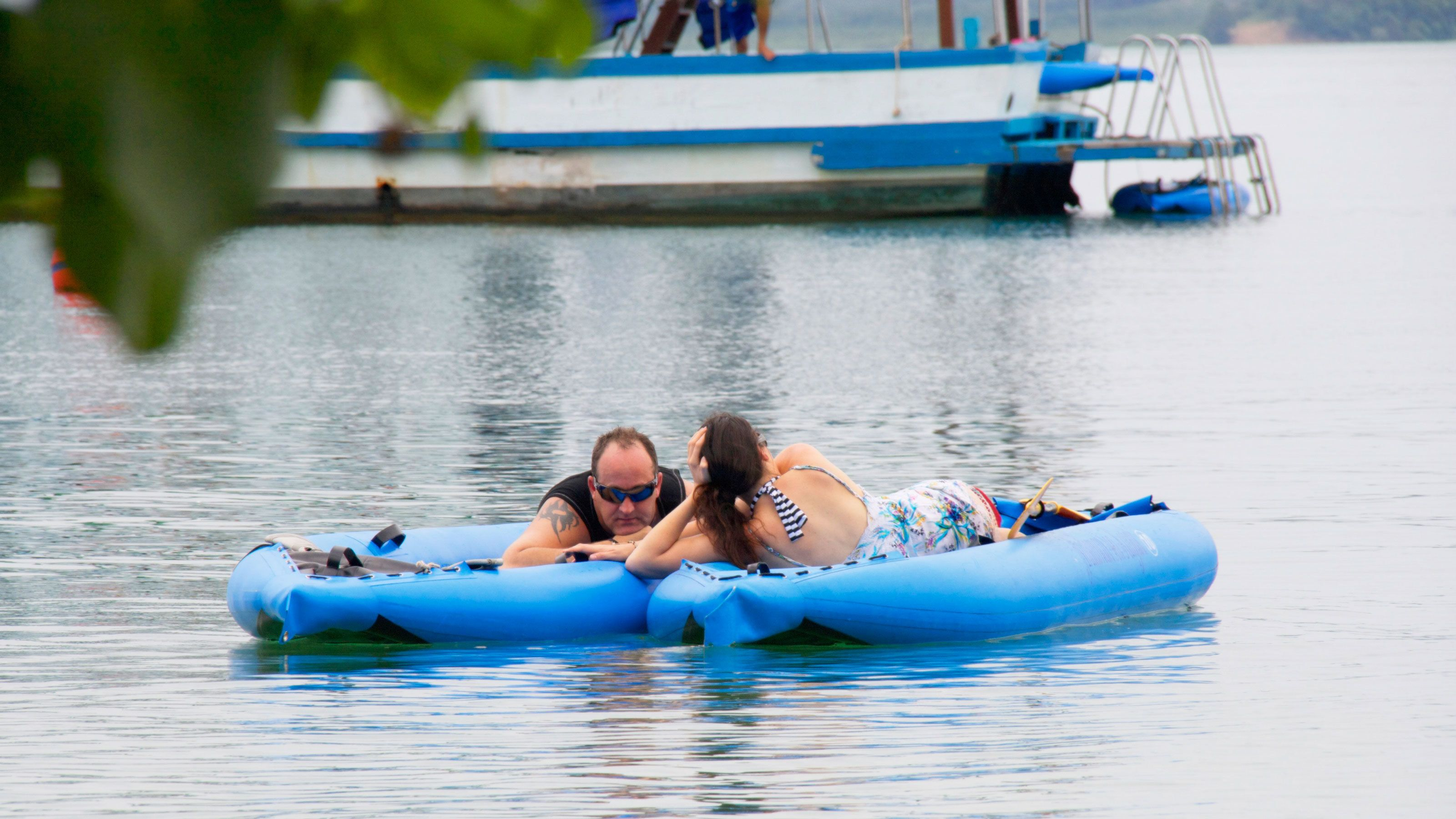couple relaxing on a floating raft in Phuket