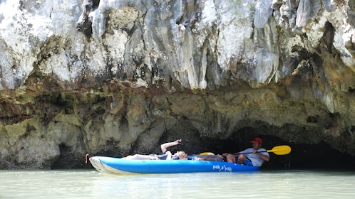 kayaking through a low hanging cave in Phuket