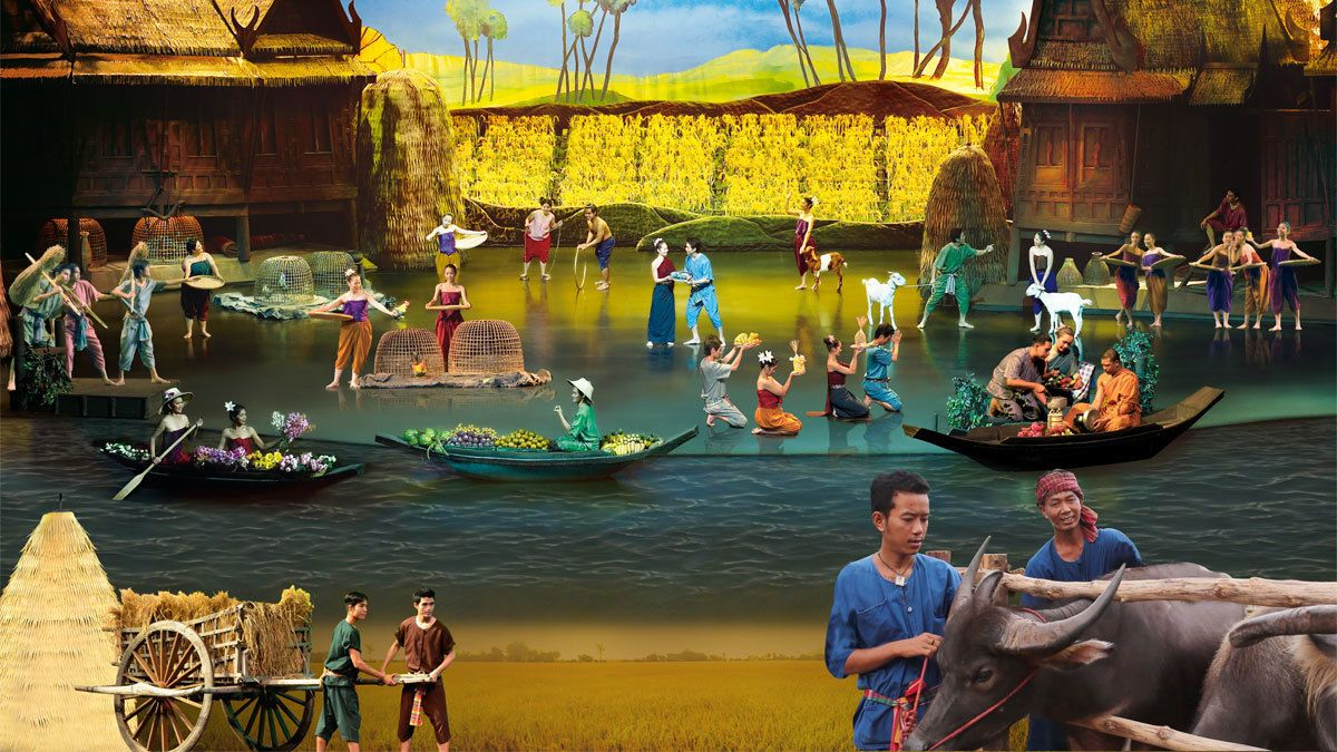performing in farmers costumes at the Siam Niramit in Thailand